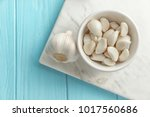 bowl with garlic cloves and... | Shutterstock . vector #1017560686