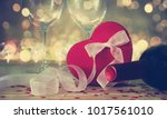 the red heart shapes gift box... | Shutterstock . vector #1017561010
