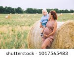 beautiful pregnant woman and... | Shutterstock . vector #1017565483