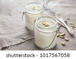 yogurt with pumpkin seeds in... | Shutterstock . vector #1017567058