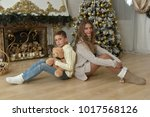 sister of a teenager and boy... | Shutterstock . vector #1017568126