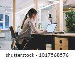young female employee spending... | Shutterstock . vector #1017568576