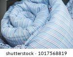 closeup of blue set of bed... | Shutterstock . vector #1017568819