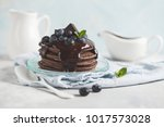 chocolate pancakes with... | Shutterstock . vector #1017573028