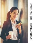 business woman with coffee make ... | Shutterstock . vector #1017578860