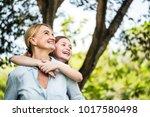 mother and daughter having fun... | Shutterstock . vector #1017580498