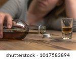 a woman  25 30  spills alcohol... | Shutterstock . vector #1017583894