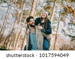 happy couple on vacation.... | Shutterstock . vector #1017594049