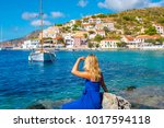 beautiful young woman tourist... | Shutterstock . vector #1017594118
