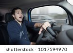 Small photo of Surprised driver in the car.?Car accident. Abrupt steering.