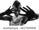 Small photo of Female person showing denial gesture,back lit light