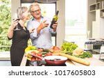 senior couple cooking healthy... | Shutterstock . vector #1017605803