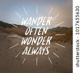 "Small photo of Inspirational quote ""wander often, wonder always"" on mountain background."