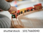 child playing with wooden train ... | Shutterstock . vector #1017660040