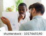 interested black client listens ... | Shutterstock . vector #1017665140
