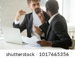 Small photo of Multiracial african and caucasian partners arguing about contract fraud, dissatisfied diverse businessmen having conflict disagree with terms, breaking agreement rejecting unacceptable conditions