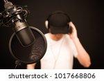 asian male singer listening... | Shutterstock . vector #1017668806