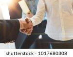business people shaking hands... | Shutterstock . vector #1017680308