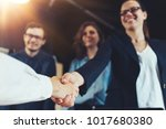 business people shaking hands... | Shutterstock . vector #1017680380