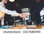 business people shaking hands... | Shutterstock . vector #1017680440