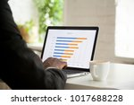 businessman analyzing monthly... | Shutterstock . vector #1017688228