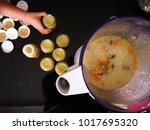 a cook blends porridge with... | Shutterstock . vector #1017695320