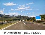 scenic view on highway road... | Shutterstock . vector #1017712390