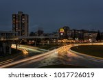 BURGAS, BULGARIA - FEBRUARY 1, 2018: Overhead pedestrian bridge at night. McDonald
