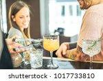 bartender preparing cocktails... | Shutterstock . vector #1017733810