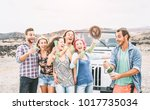 group of happy friends making... | Shutterstock . vector #1017735034