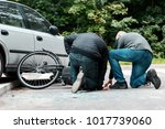accident witness helping an... | Shutterstock . vector #1017739060