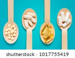 Healthy Supplements On Wooden...