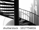 black metal round stair with...
