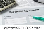 a purchase agreement with a pen ... | Shutterstock . vector #1017757486