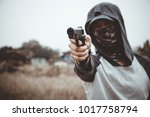 criminal in a mask and hood...   Shutterstock . vector #1017758794