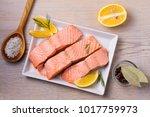 boiled salmon on white plate.... | Shutterstock . vector #1017759973