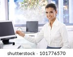 happy young woman working in... | Shutterstock . vector #101776570