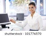 happy young woman working in... | Shutterstock . vector #101776570