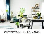 black chair at round table in...   Shutterstock . vector #1017775600