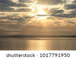 sunrise on the sea with the... | Shutterstock . vector #1017791950