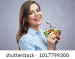 smiling business woman eating... | Shutterstock . vector #1017799300