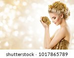 fashion model hold gold jewelry ... | Shutterstock . vector #1017865789