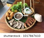 Small photo of Vietnamese food set, bun dau mam tom, popular street food made from vermicelli with boiled pork, fried tofu, shrimp paste and green vegetables and lemon