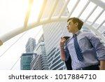 asian businessman standing... | Shutterstock . vector #1017884710