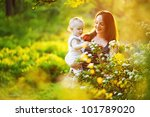 mother and her child in spring... | Shutterstock . vector #101789020