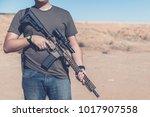 man on desert range posing with ... | Shutterstock . vector #1017907558