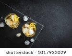 whiskey on the rocks with lemon ...   Shutterstock . vector #1017932029