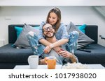 young couple sitting on the... | Shutterstock . vector #1017938020