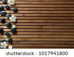 black massage pebbles and spa... | Shutterstock . vector #1017941800