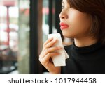 red lips woman wiping her mouth ... | Shutterstock . vector #1017944458